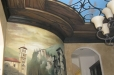 Faux wood and iron with night sky on ceiling, Mural of old town on wall