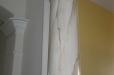 Faux marble column.