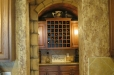 Faux stone wall, wine room. Textured faux finish in kitchen.