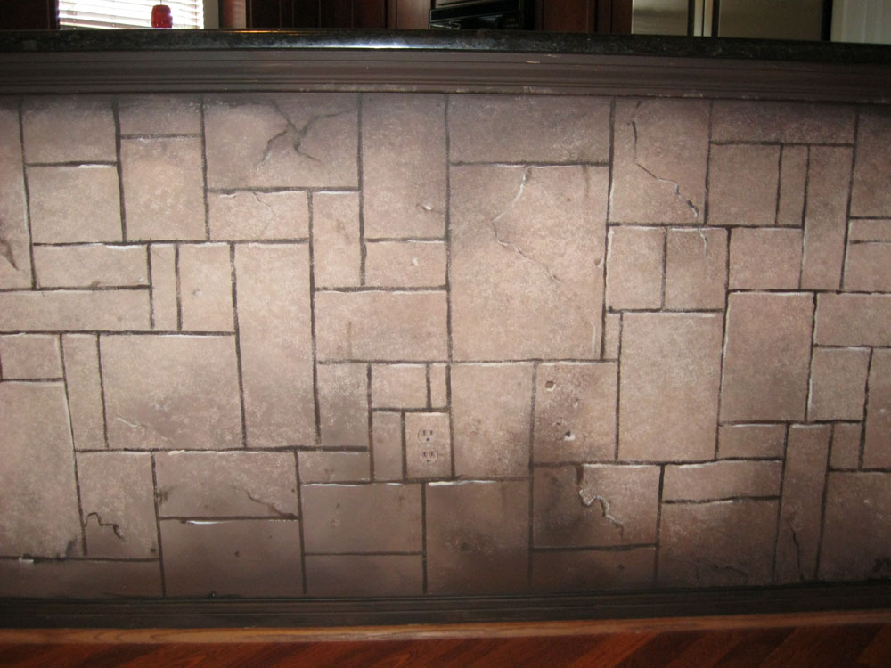 Faux stone wall.